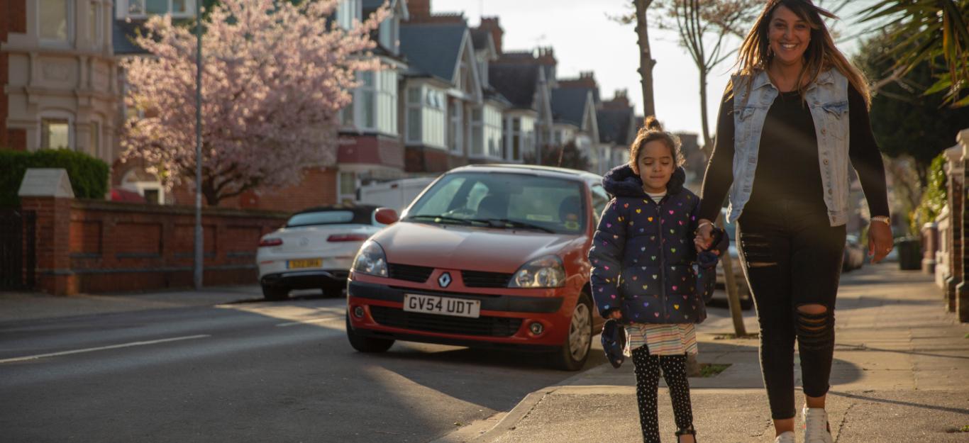 Child being taken to school>